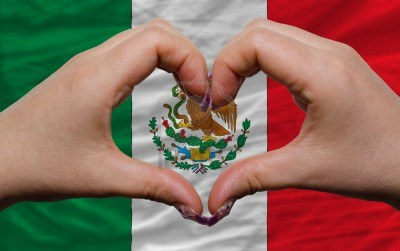 12478801-gesture-made-by-hands-showing-symbol-of-heart-and-love-over-national-mexico-flag